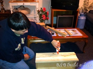 Bill gluing the lattice before adhering the pieces to the front of the drawers as well as the sides of the chest.