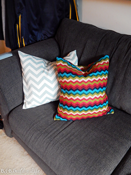 ironing board cover on clearance is turned into an awesome chevron pillow at BandBBuildALife.com