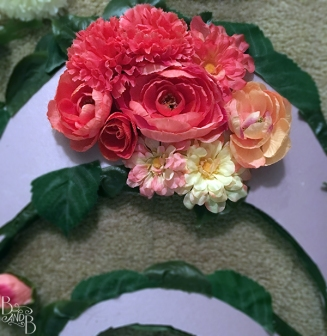 glue flowers to foam cut out letters to make DIY Floating monogram initial letters to decorate pool at wedding