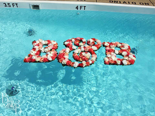 DIY Floating monogram initial letters to decorate pool at wedding