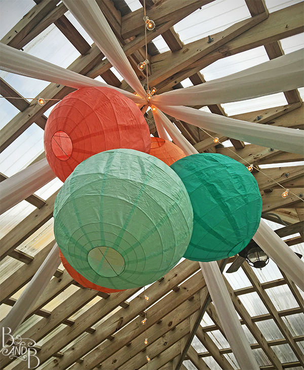 paper lantern chandelier for teal and coral outer banks wedding
